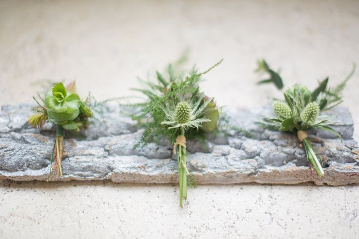 Naturally beautiful buttonholes for the groom and groomsmen created with soft foliages and thistle