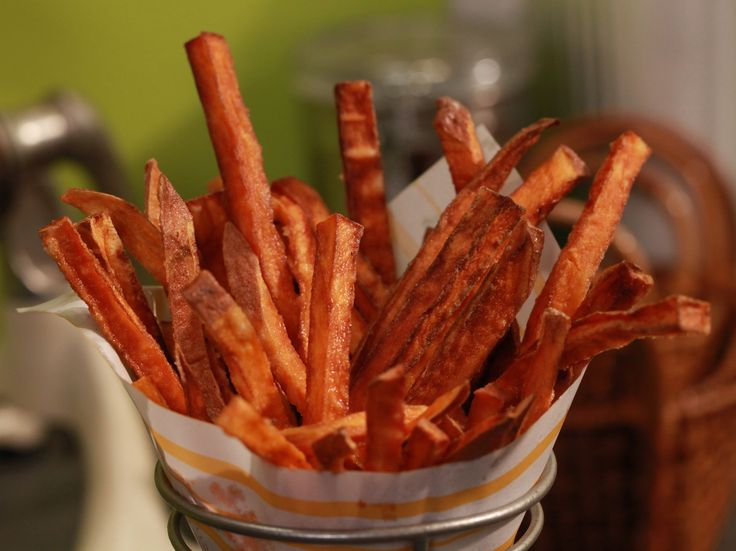 Sweet Potato Fries from FoodNetwork.com Mix 1 cup cornstarch & 3/4 cup cold club soda.  Dip potatoes in this mixture before frying for crispy fries.