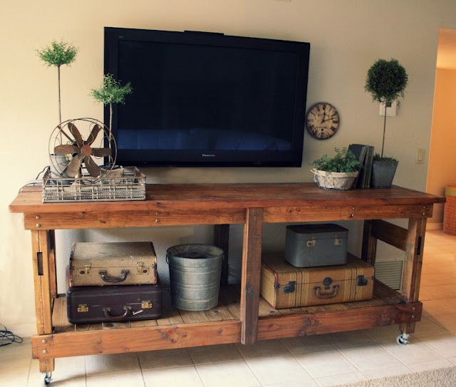 Industrial workbench made from upcycled pallet wood used as an entertainment center.