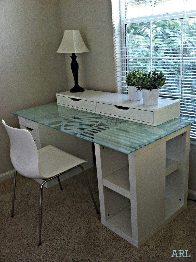 Beautiful, glass-topped Ikea desk hack.