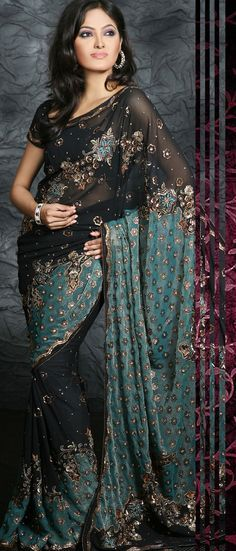 Black Faux Georgette Saree with Blouse  this one's very nice all around, if black is okay.