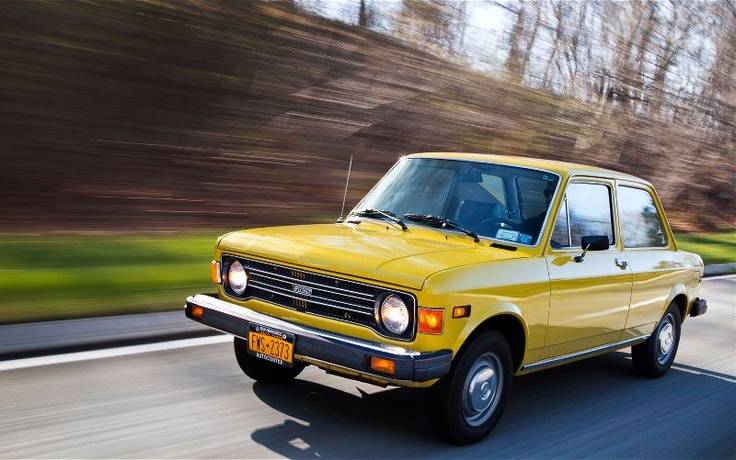 1979 Fiat 128, bright yellow. this is EXACTLY my first car, Tweety. though ours had a smoothed front end with a chicken wire grill. Best. Car. Ever.