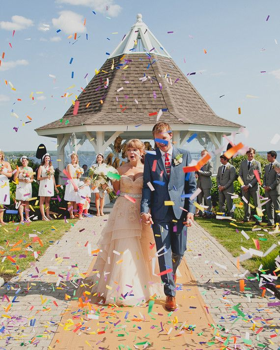 "Massive amounts of rainbow confetti was tossed as the bride and groom recessed up the aisle. ""Even though we knew it was coming, I think we were unprepared for the actual effect,"" said the bride. ""It felt like we had just won 'So You Think You Can Dance.'"" As for the groom, he had completely forgotten about the confetti exit, and was totally surprised when it happened."