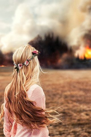 I like the contrast between beautiful romantic girl and a violent fire.