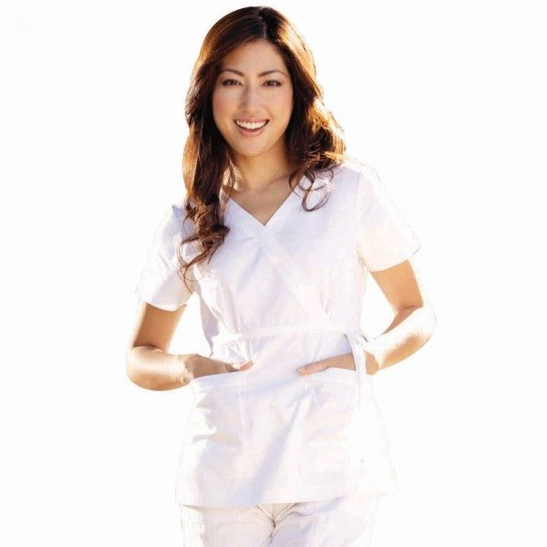 Koi Katelyn Top in White. The koi Katelyn top is designed with stunning detail. This scrub top is wrap style top with adjustable ties. This scrub top is great for the bustier woman as it ties under the bust and skims the waist offering a flattering look. £27.50  #medicalscrubs #nursescrubs #dentistscrubs #nurses #dentists #whitescrubs #nurseuniform