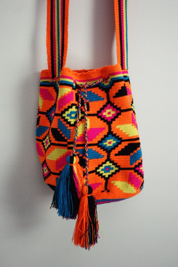 Wayuu Taya Foundation Susu Bag. Handmade tribal print bags by the women of the Wayuu indigenous tribe. All proceeds benefit indigenous families and children. www.wayuustore.com