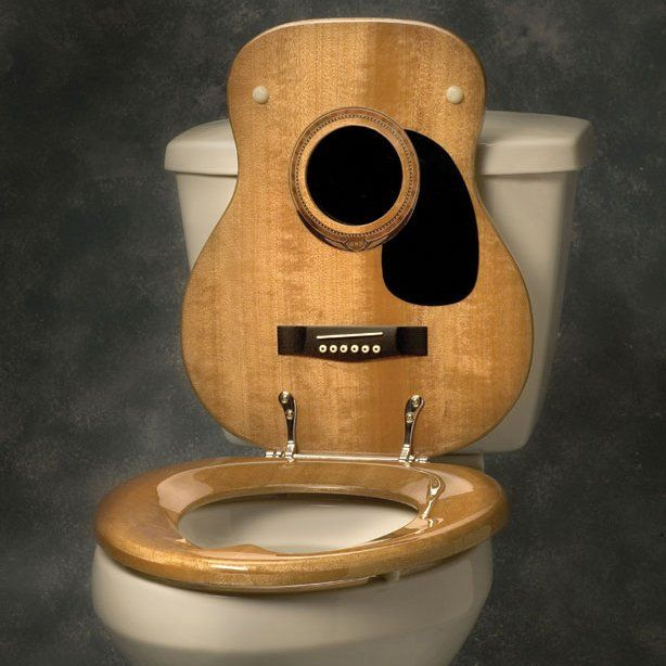 "This Guitar Toilet Seat from Jammin Johns features an acoustic guitar shape and a real guitar finish in natural wood or white, real guitar parts and chrome hinge. Available in round or elongated seat. Made of wood & chrome. 4"" h x 21"" l x 17"" w. Please allow 1-2 weeks for shipping."