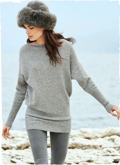 An ultra-chic essential, the tunic is knit of sublimely soft, woolen-spun baby alpaca. Styled with a rolled neck, drop shoulders and dolman sleeves. Extra-long rib knit trim at the cuffs and hem create a subtle blouson shape.