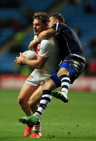 Canberra Raiders Elliott Whitehead of England is tackled by Danny Brough of Scotland during the Four Nations match between the England and Scotland at The Ricoh Arena on November 5, 2016 in Coventry, United Kingdom.