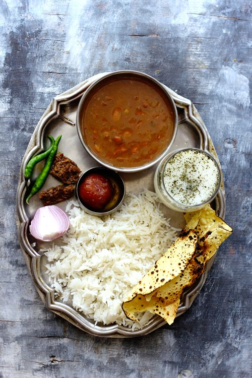 Rajma - Chawal is one of the favorite weekend lunch combination. Spicy Rajma Masala served with steamed rice, papad, chaas and pickle is soul satiating kind of a combination. funfoodfrolic.com