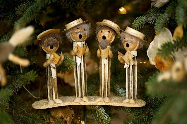 Folk art carolers made from okra pods and walnut shells.