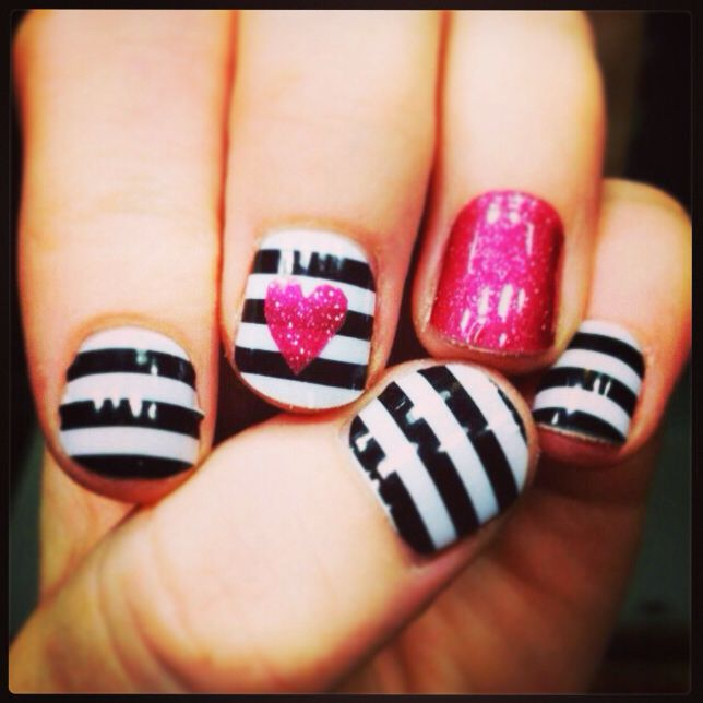 You can use a paper punch on Jamberry nail wraps and layer them for cute designs!