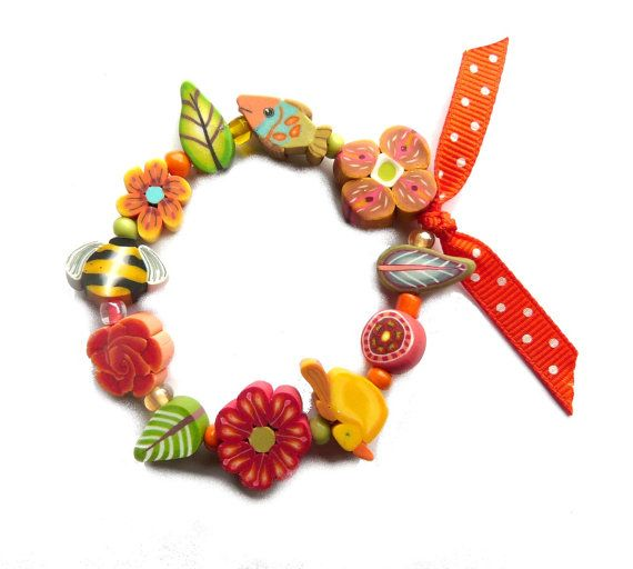 Hey, I found this really awesome Etsy listing at https://www.etsy.com/listing/242614220/child-bracelet-bee-bird-flowers-and-fish
