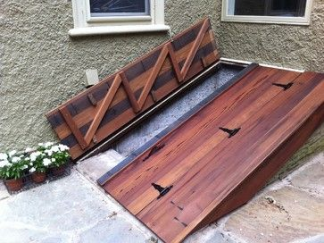 basement entrance basement stairs cellar doors yard landscaping photo