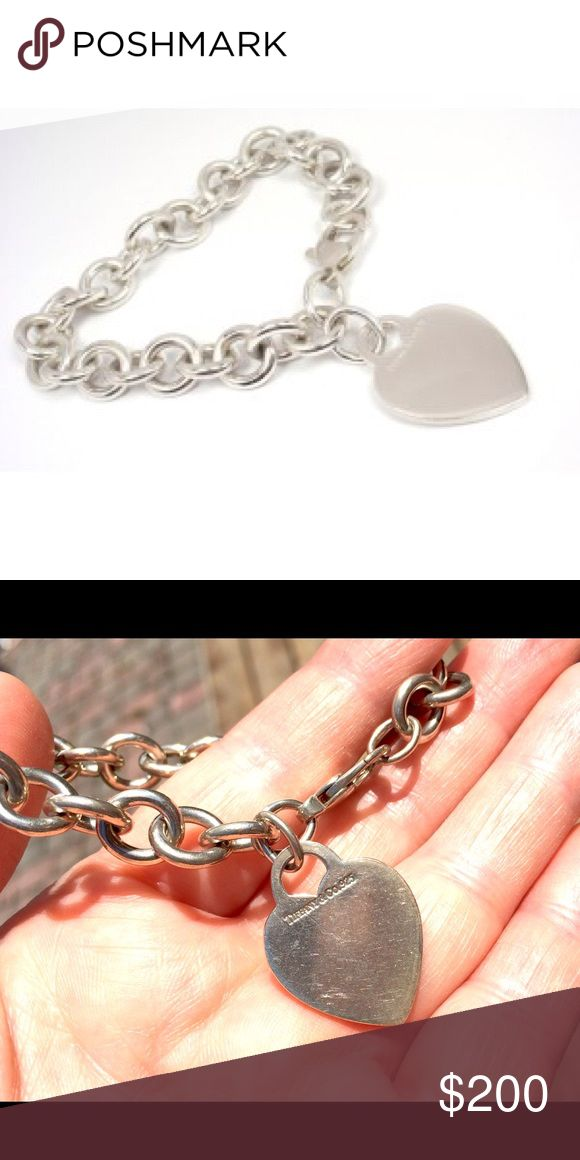 """TIFFANY & CO. Charm Bracelet with Heart Tag. Gently Worn Pre-Loved Condition: TIFFANY & CO. Charm Bracelet with Heart Tag. 925 Sterling Silver chain link bracelet with Tiffany & Co engraved heart ornament and lobster clasp closure. Light, visible surface scratches. Measures (approximately) bracelet: 7.5""""L (incl. clasp) x .25""""W and Tag: 1.25""""Hx .75""""W. Estimated Original Retail $300. (No offline transactions) Tiffany & Co. Jewelry Bracelets"""