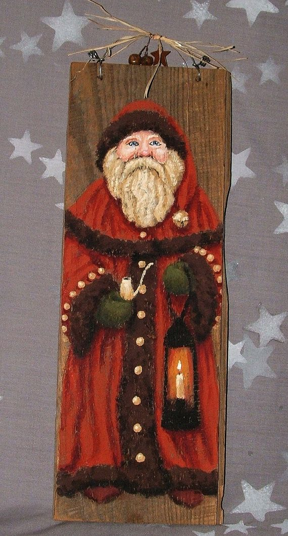 St. Nick is warmly dressed in a terracotta red cape coat with brown fur trim and lots of bells for extra jingle! He puffs a clay pipe, using his