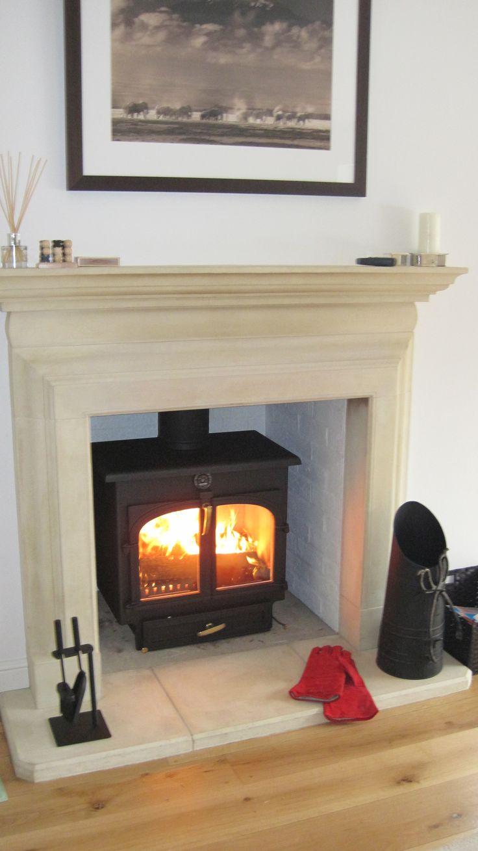 Clearview 650 wood burner in metallic black - set in a beautiful limestone fireplace