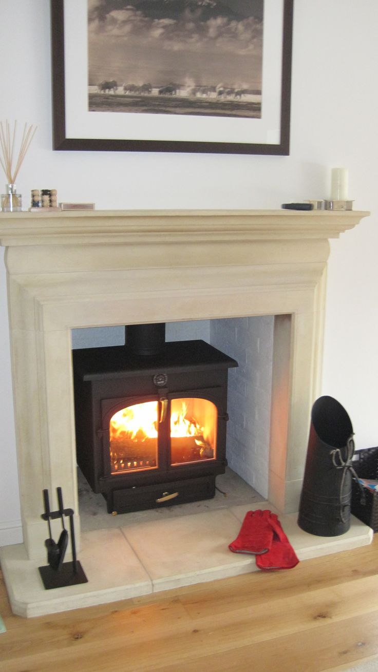 Clearview 650 Wood Burner In Metallic Black Set In A
