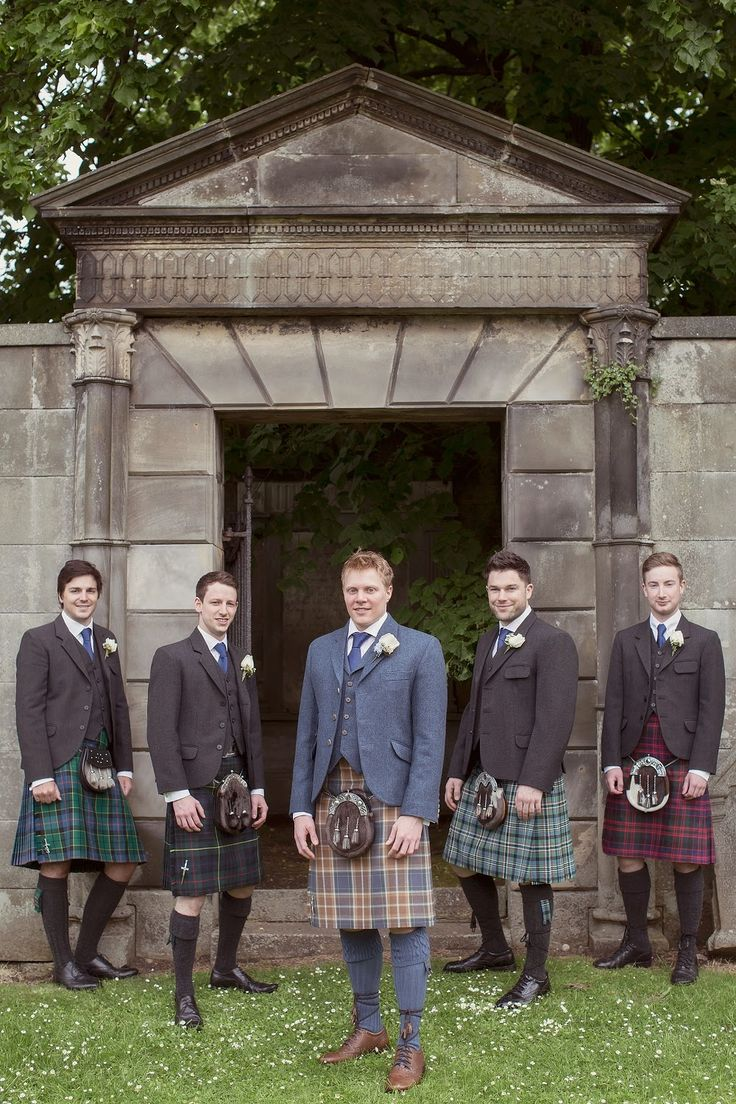 Peonie Cole At Home: Groom in blue tweed jacket and ushers in grey tweed jackets and kilts at Cramond Kirk, Edinburgh, Scotland. Photograph by Craig and Eva Sanders.