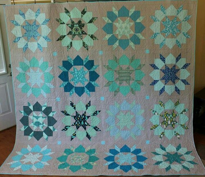 Swoon quilt with darker background....most are done with white background fabric.