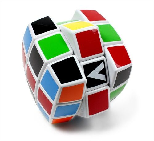 """V-Cube 3 is the 3x3x3 member of the V-Cube family. Many """"cubers"""" prefer the smooth rotation of the V-Cube 3 over the original Rubik's Cube. This pillow-shaped version adds to the streamlined shape and movement of the cube. The V-Cube 3 has forty-three  $19.99"""