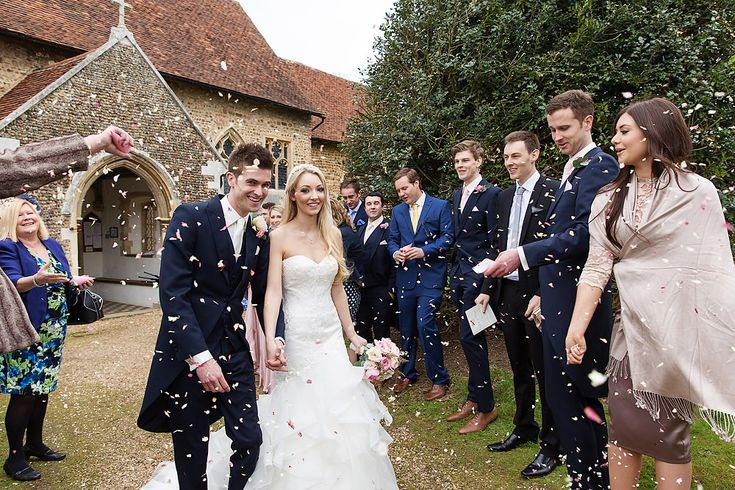 Braxted Park Wedding Photography - Pronovias Olate Wedding Dress & Jimmy Choo Shoes for a classic wedding with Pink Colour scheme. Bridesmaids in Ghost Dresses, Groomsmen in Tails.