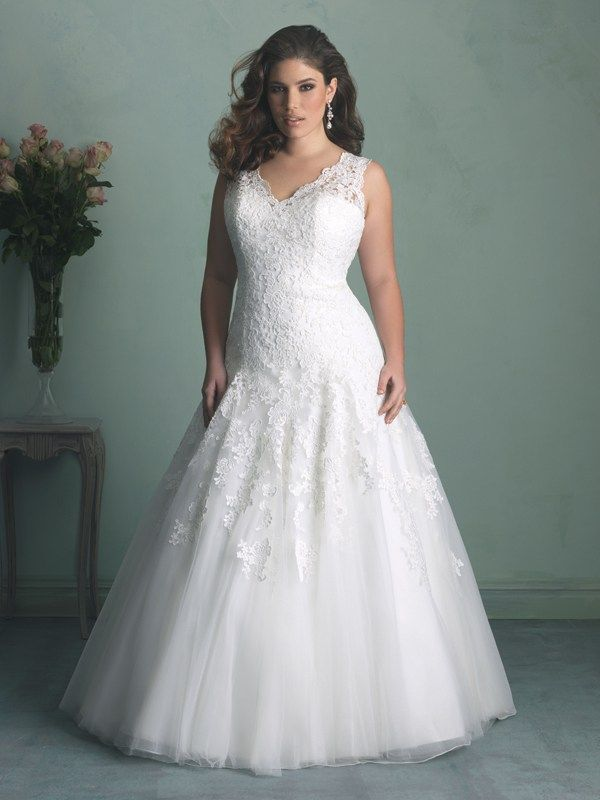 W343 Allure Women Bridal Gown - Equal parts breathtaking and timeless, this wedding gown A-line silhouette  features all-over lace and trailing appliqué on the English net skirt.