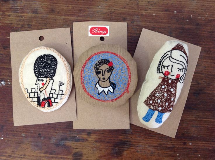 Embroidered  brooches.