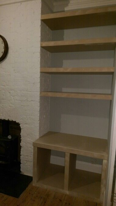 lounge storage with log store and floating shelves, made from MDF by me www.ManCaveCreations.co.uk