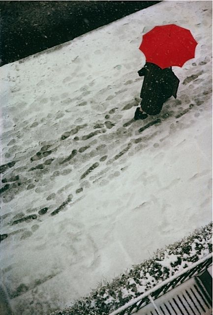 I like how this photo seems all drab and dreary, all except for the bright red umbrella. The color contrast between the snow and the umbrella really makes the picture for me. by Saul Leiter Footprints, 1950