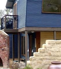 house cladding timber stone iron orb - Google Search