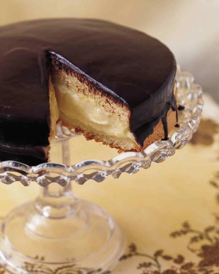 This American classic, first made by a Boston chef in the 1850s, isn't actually a pie at all, it's a cake: two sponge layers with custard-cream filling and a shiny chocolate glaze. This recipe calls for a 9-by-2-inch cake pan; if you use an 8-inch wide pan, the batter will overflow.