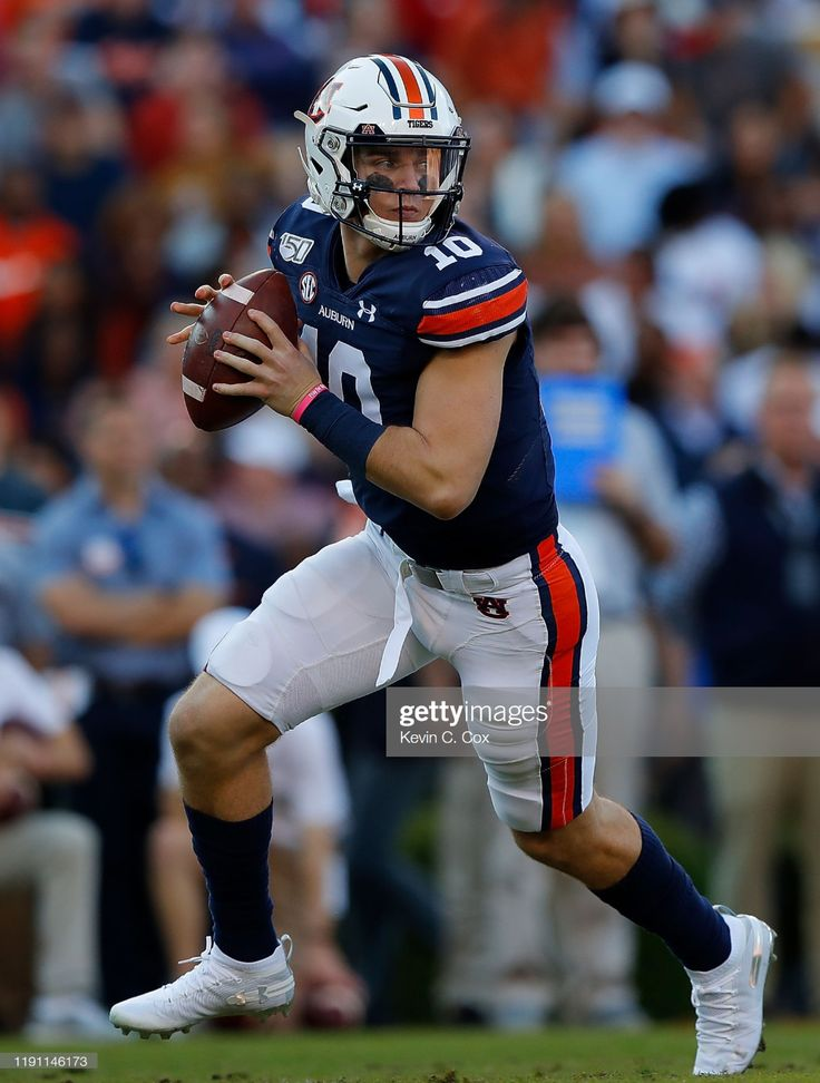 Bo Nix of the Auburn Tigers looks to pass against the