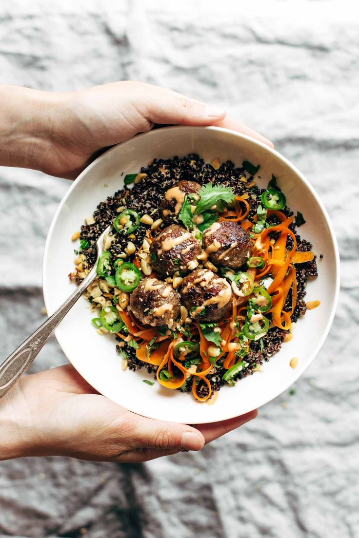 Banh Mi Bowls! A quick and easy meal featuring quinoa or rice topped with quick pickled carrots, herbs, peanuts, and easy lemongrass pork meatballs, all covered with spicy mayo. | pinchofyum.com