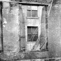 Photograph of a Window and Fire Escape after the Triangle Shirtwaist Factory Fire