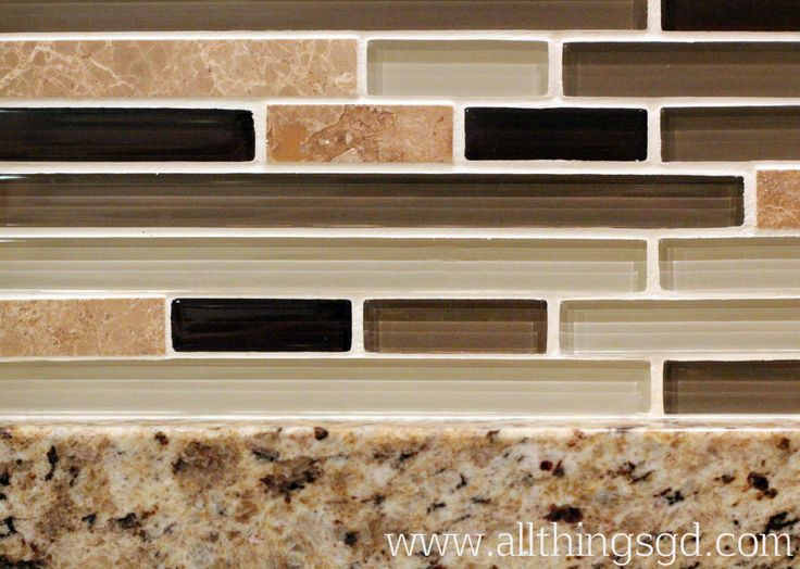 Look how the glass tile backsplash contains all of the colors from the granite. Pretty!