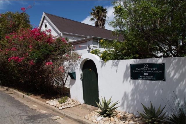 22 Van Wijk Street in Franschhoek. lovely budget guest house accommodation with four beautifully furnished rooms. Rooms are furnished with comfortable beds and have private bathrooms. In the lounge adjacent to the single room there is one single bed which could be utilised by three singles or a family of three, but they will have to share the bathroom. #franschhoek #capewinelands