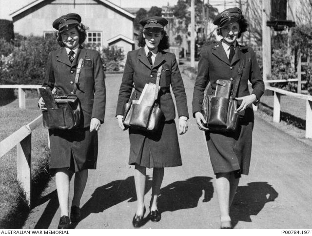 Three Victorian Railways tram conductresses at Elwood Depot, circa 1944.