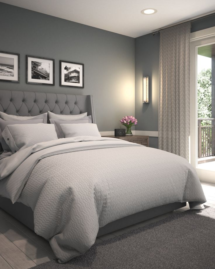Don't love the greys being this dark necessarily but love the bed frame and pictures above the bed