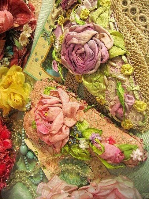 One of the most amazing pictures I've seen of ribbon embroidery.  This is actually encrusted with layer upon layer of it! Amazing! Susan
