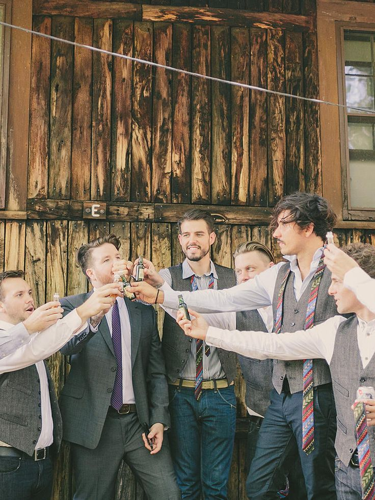Gather the groomsmen together to take a shot for a celebratory wedding photo idea.