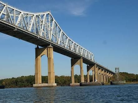 """The Outerbridge Crossing is a cantilever bridge which spans the Arthur Kill. The """"Outerbridge"""", as it is commonly known, connects Perth Amboy, New Jersey, with Staten Island, New York, and carries NY 440 and NJ 440, each road ending at the respective state border. The Outerbridge Crossing is one of three bridges connecting New Jersey with Staten Island, with the Bayonne Bridge (which also carries NJ 440 and NY 440) in Bayonne and the Goethals Bridge in Elizabeth being the other two.  The…"""