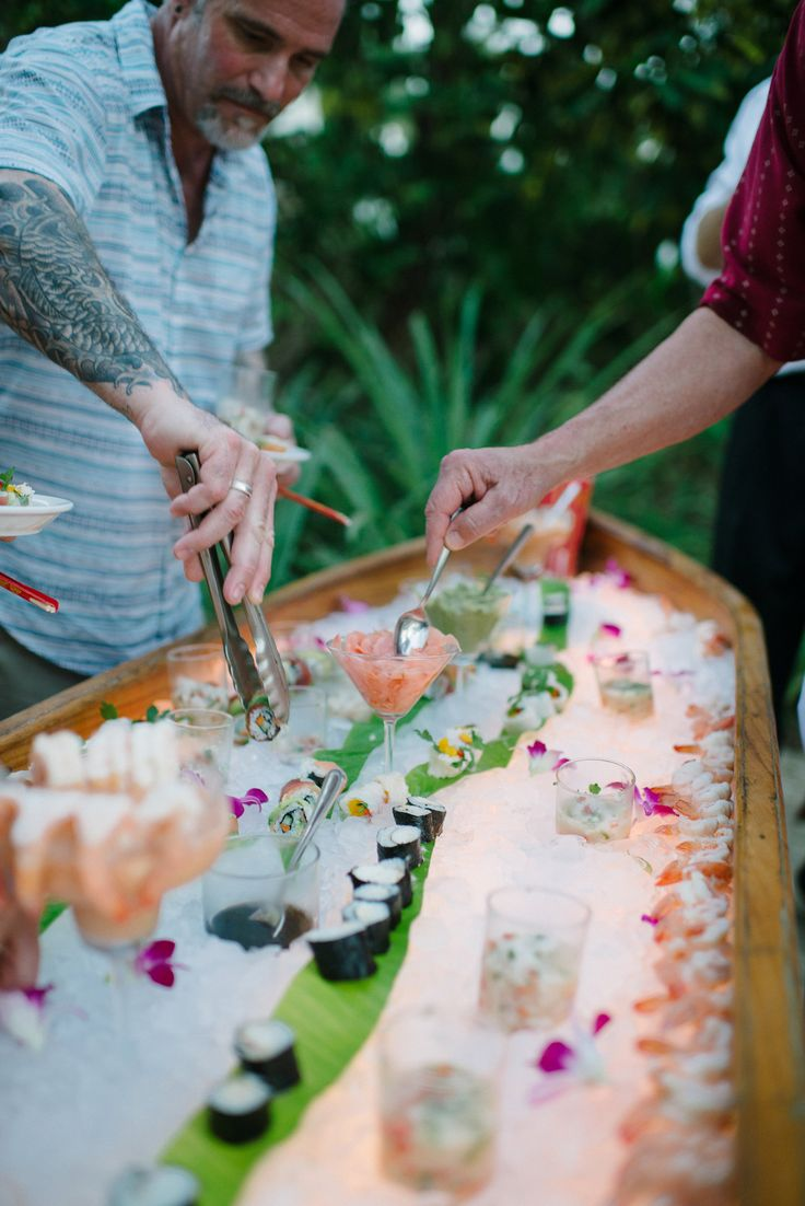 Sushi boat bar! | Photography: Margaux Photography - www.margauxphotography.com  Read More: http://www.stylemepretty.com/destination-weddings/costa-rica-weddings/2014/04/24/casual-costa-rica-wedding-at-villa-marrakech/: