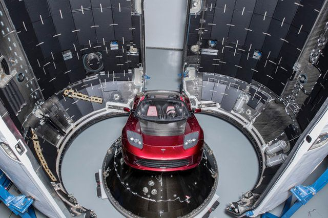 SpaceX CEO Elon Musk's midnight cherry red Tesla Roadster, which will be launched into space on the first Falcon Heavy rocket test flight, is seen before encapsulation inside its protective payload fairing. SpaceX's debut Falcon Heavy rocket will launch i