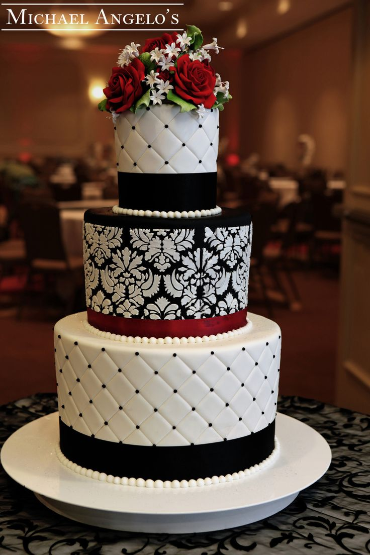 Classic Damask - Cake is made of three double layers to give it a very unique and impressive look. Two layers are hand stiched with black dots, while the middle layer shows off a beautiful damask finish. Stunning!