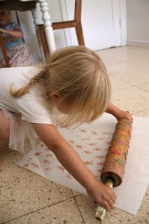 Rolling Pin Printing, just stick design to rolling pin, coat with paint and roll on paper!