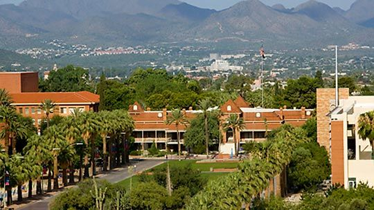 View of University of Arizona's campus and surrounding mountain ranges in the large city of Tucson