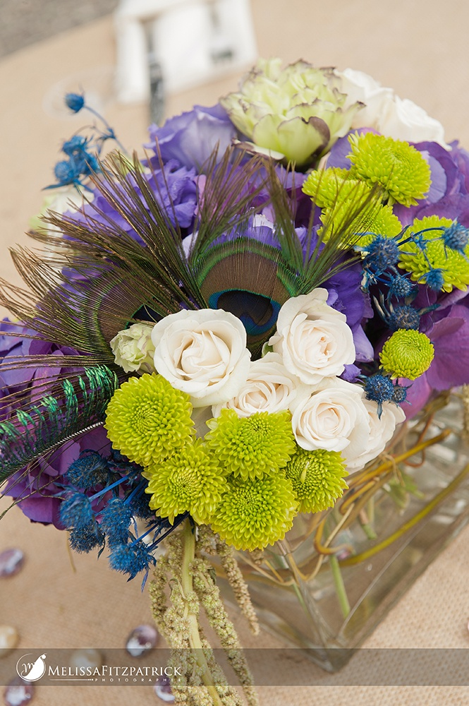 Centerpieces with peacock feathers color choice in floral