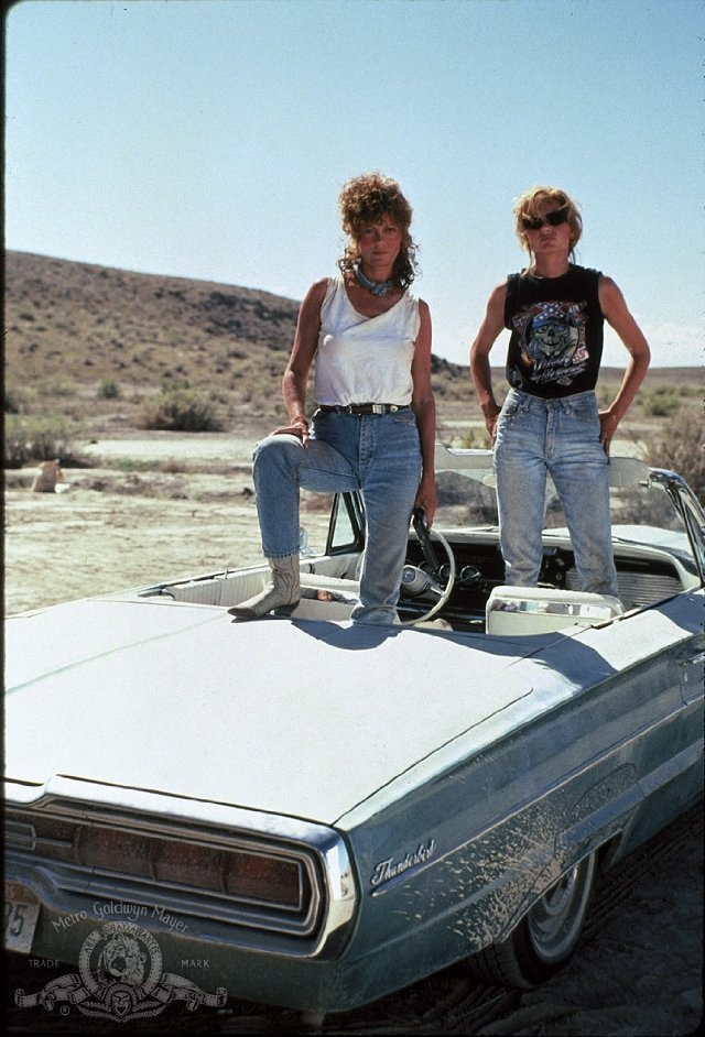 """May 24 - ON THIS DAY in 1991, critically acclaimed road movie """"Thelma and Louise"""" debuted in theaters, stunning audiences with a climactic scene in which its two heroines drive off a cliff into the Grand Canyon, in a vintage 1966 green Ford Thunderbird convertible!"""