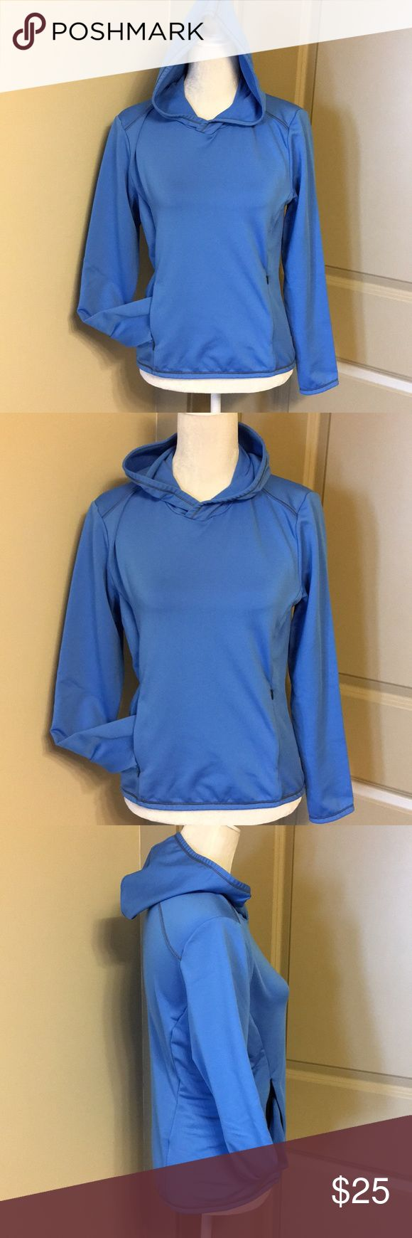 Lucy brand pullover This is a super comfortable and form flattering pullover from Lucy Brand. It's a pretty blue color.  It's hooded and has two front zipper pockets that make one big kangaroo pocket. It's slightly longer in the back than front. It's in excellent condition. Lucy Tops Sweatshirts & Hoodies